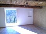 Maison mitoyenne avec terrain, garage et cabanon 2/5