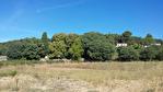 LORGUES beau terrain plat de 1200 m2 proche du village. 1/4