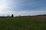 TAVERNES, beau terrain plat proche village. 1/3