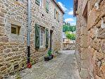 CORREZE. Village of Correze.  Stunning stone house with 5 bedrooms, garage and balcony. 3/18