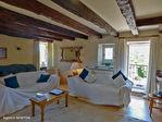 LOT.  Cavagnac.  Magnifique maison en pierre avec 3 chambres, 3 gites spacieux en pierre, grange et piscine. 7/18
