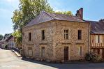 Correze. Segur-le-Château. Maison en pierre datant de 1911 sur le bord de la rivière Auvezere. 2/18