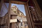 Correze. Segur-le-Château. Maison en pierre datant de 1911 sur le bord de la rivière Auvezere. 3/18