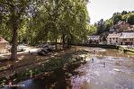 Correze. Segur-le-Château. Maison en pierre datant de 1911 sur le bord de la rivière Auvezere. 5/18