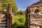 Correze. Segur-le-Château. Maison en pierre datant de 1911 sur le bord de la rivière Auvezere. 17/18