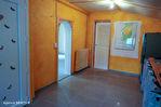 CORREZE.  Proche de TREIGNAC.  Maison avec 2 chambres sur un niveau avec garage et 2 pieces studio séparé. 8/18