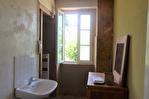 CORREZE.  Chamboulive.  Maison en pierre avec 4 chambres (potentiel pour 5), puits, four à pain, atelier, abri de voiture et jardins de 925m2. 16/18