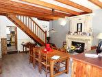 Située aux portes de Cognac, dans un superbe environnement boisé, maison charentaise en très bon état 3/12