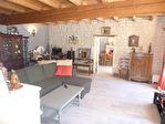Située aux portes de Cognac, dans un superbe environnement boisé, maison charentaise en très bon état 4/12
