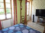 Située aux portes de Cognac, dans un superbe environnement boisé, maison charentaise en très bon état 7/12