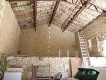 Située aux portes de Cognac, dans un superbe environnement boisé, maison charentaise en très bon état 10/12