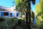 Saujon - Maison de ville d'environ 172 m² avec jardin, parking et garage 1/12