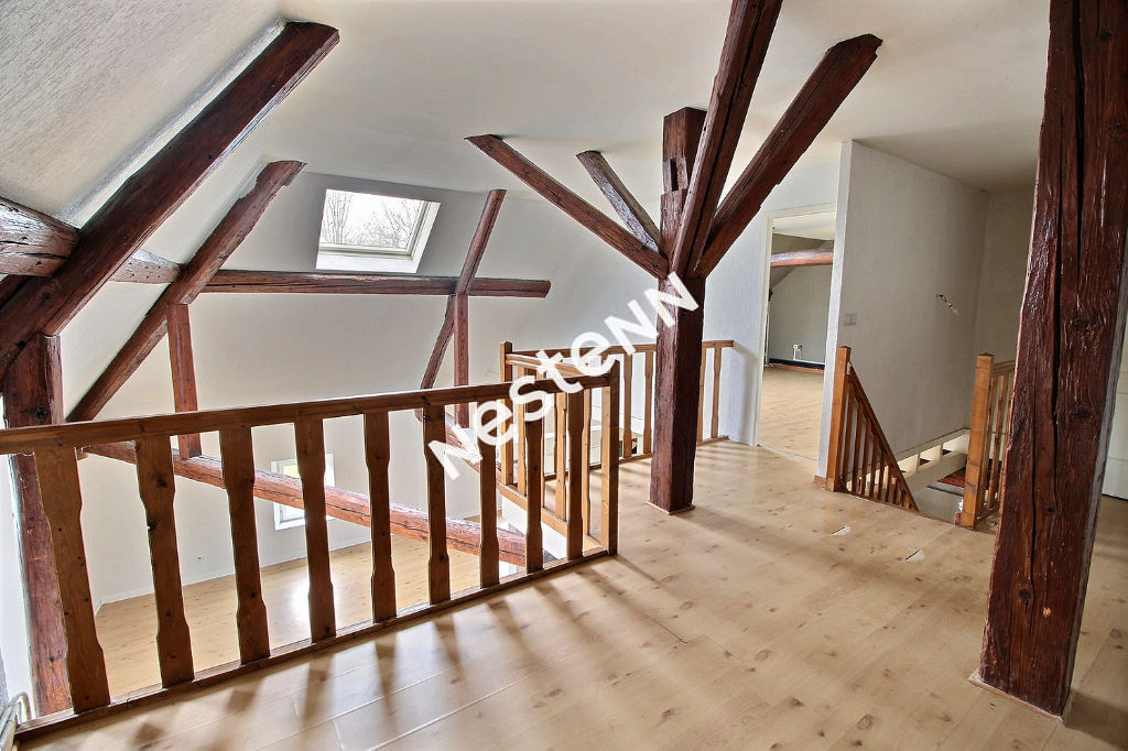 Appartement coup de c?ur - plafond cathédral