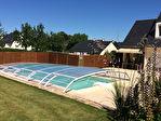 Maison de 154 m2 sur 2450 m² de terrain avec piscine couverte et deux doubles garages. 5/13