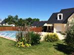Maison de 154 m2 sur 2450 m² de terrain avec piscine couverte et deux doubles garages. 13/13