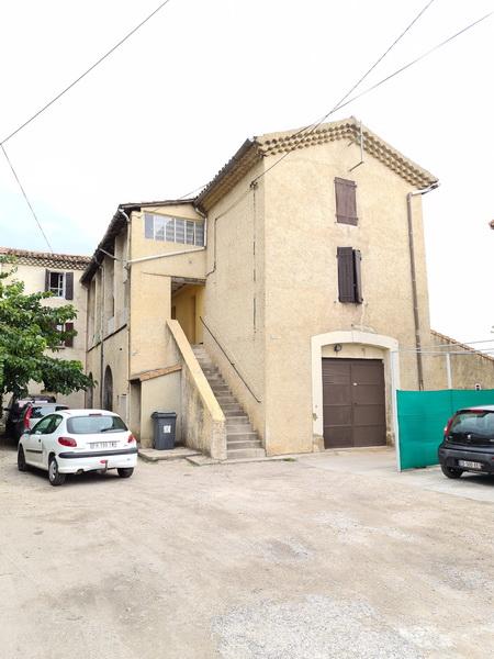 Immeuble de rapport (12 % brut) 8 appartement de type 2, garages, caves