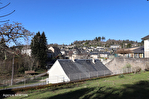 CORREZE.  Town of Correze.  Stone house with a wonderful view, 6 bedrooms (or 4 and a separate apartment). Large garage and workshop. Gardens of 1,256m2 3/18