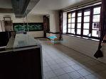 Immeuble abritant un superbe espace en RDC, logement et dépendances 7/18