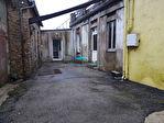 Immeuble abritant un superbe espace en RDC, logement et dépendances 11/18