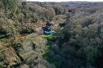 Ancien moulin fondé en titre sur un terrain de 5 ha, avec dépendance. 2/18